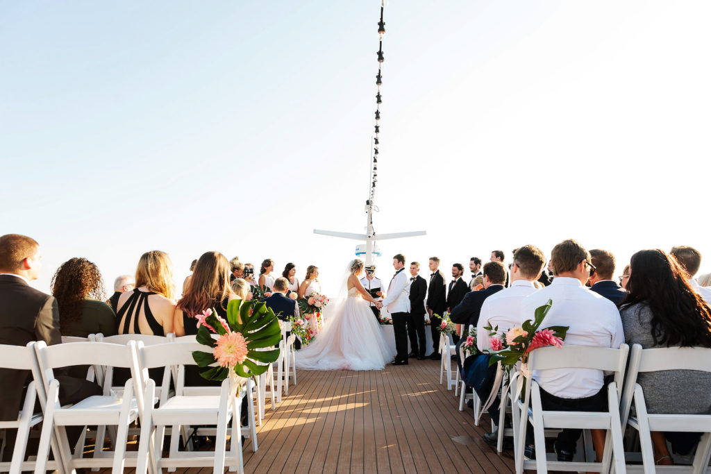 Tropical Bride and Groom Exchanging Wedding Vows on Waterfront Wedding Venue Yacht StarShip   Tampa Bay Wedding Photographer Limelight Photography