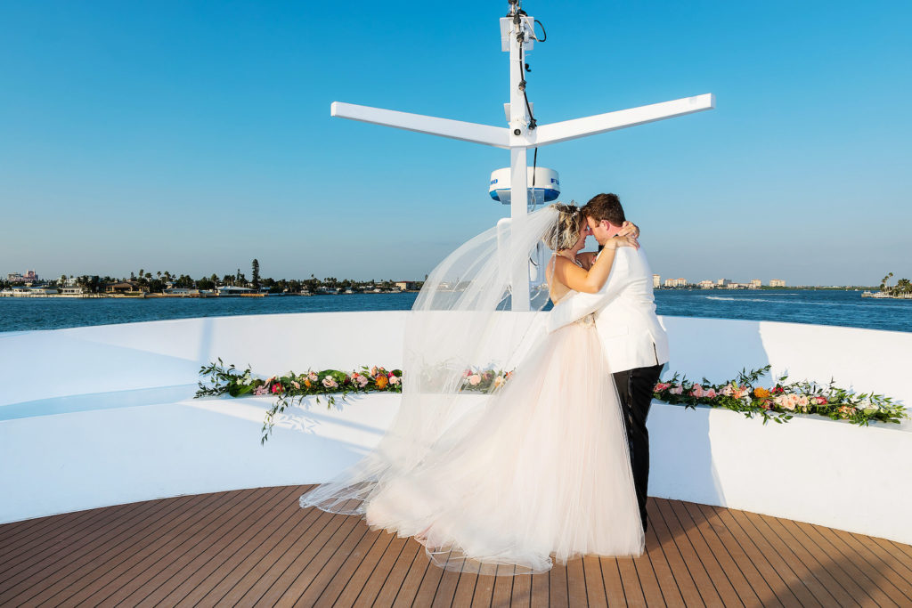 Romantic Bride in Princess Ballgown Pink Lining Tulle Skirt Wedding Dress, Full Length Veil and Groom in White Tuxedo   Waterfront Wedding Venue Yacht StarShip   Tampa Bay Wedding Photographer Limelight Photography