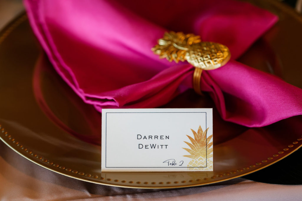 Tropical Wedding Reception Decor, Gold Charger with Hot Pink Linen Napkin and Gold Pineapple Ring Holder, White and Gold Pineapple Foil Stamped Seating Place Card   Tampa Bay Wedding Photographer Limelight Photography