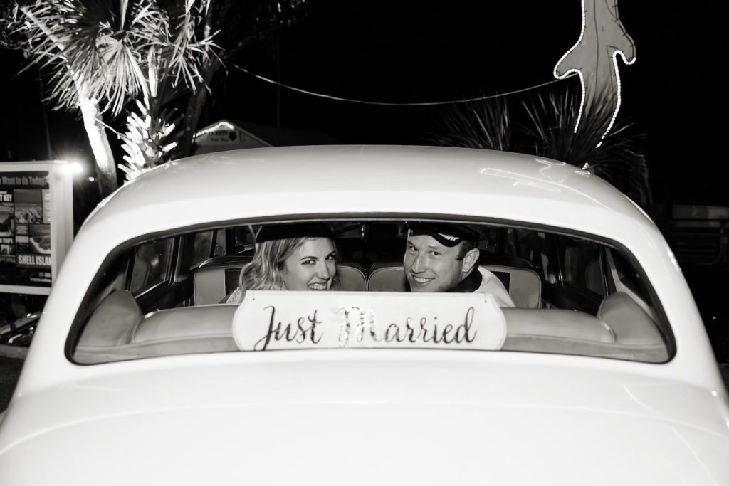 Florida Bride and Groom in Wedding Reception Getaway Car and Just Married Sign   Tampa Bay Wedding Photographer Limelight Photography