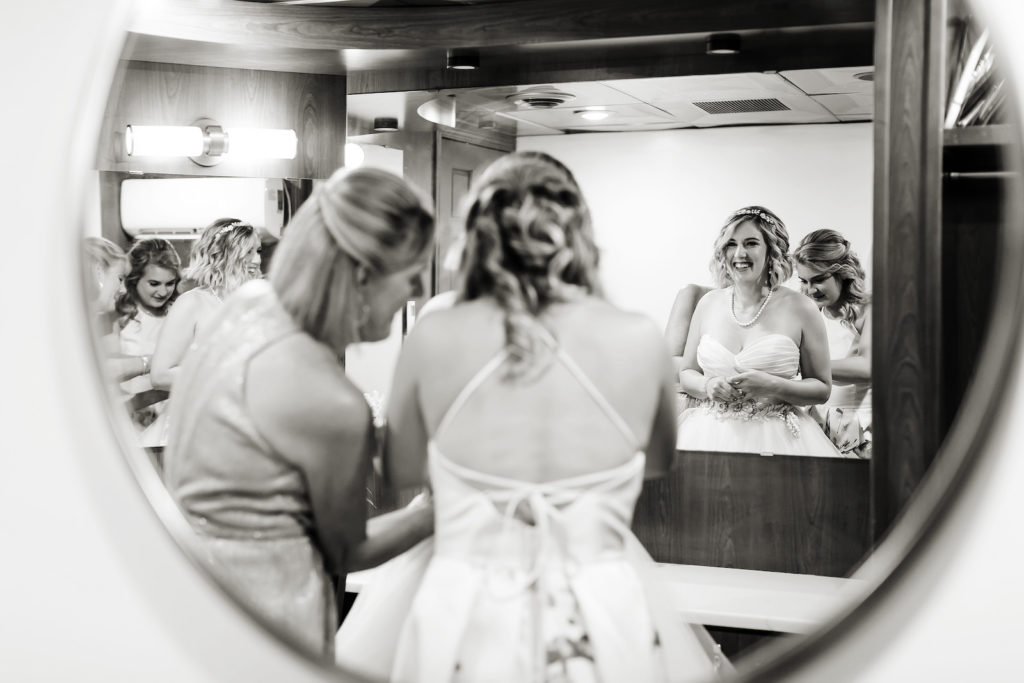 Florida Bride Getting Wedding Ready Putting on Ballgown Strapless Dress with Bridesmaids   Tampa Bay Wedding Photographer Limelight Photography