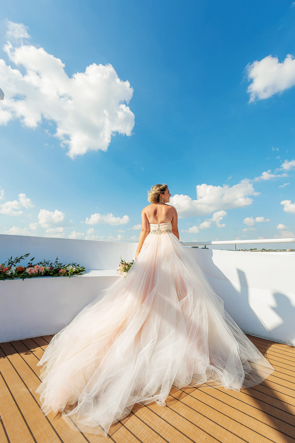Florida Bride Wearing Princess Ballgown Strapless Tulle Skirt with Blush Pink Lining and Floral Belt Wedding Dress on Deck of Waterfront Wedding Venue Yacht StarShip   Tampa Bay Wedding Photographer Limelight Photography