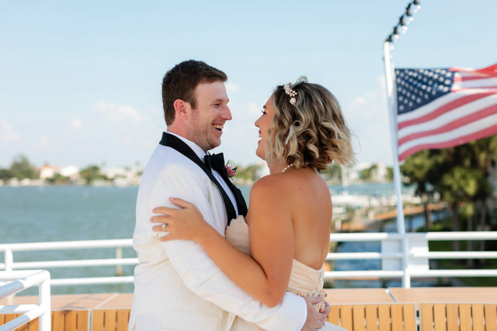 Florida Bride and Groom in White Tuxedo First Look Portrait   Waterfront Wedding Venue Yacht StarShip   Tampa Bay Wedding Photographer Limelight Photography