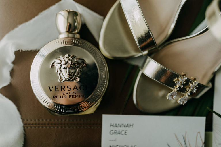 Bridal Elegant Wedding Accessories, Versace Perfume Bottle, Silver Strappy Wedding Shoes, Dangling Rhinestone Gold Earrings | Tampa Bay Wedding Photographer Amber McWhorter Photography