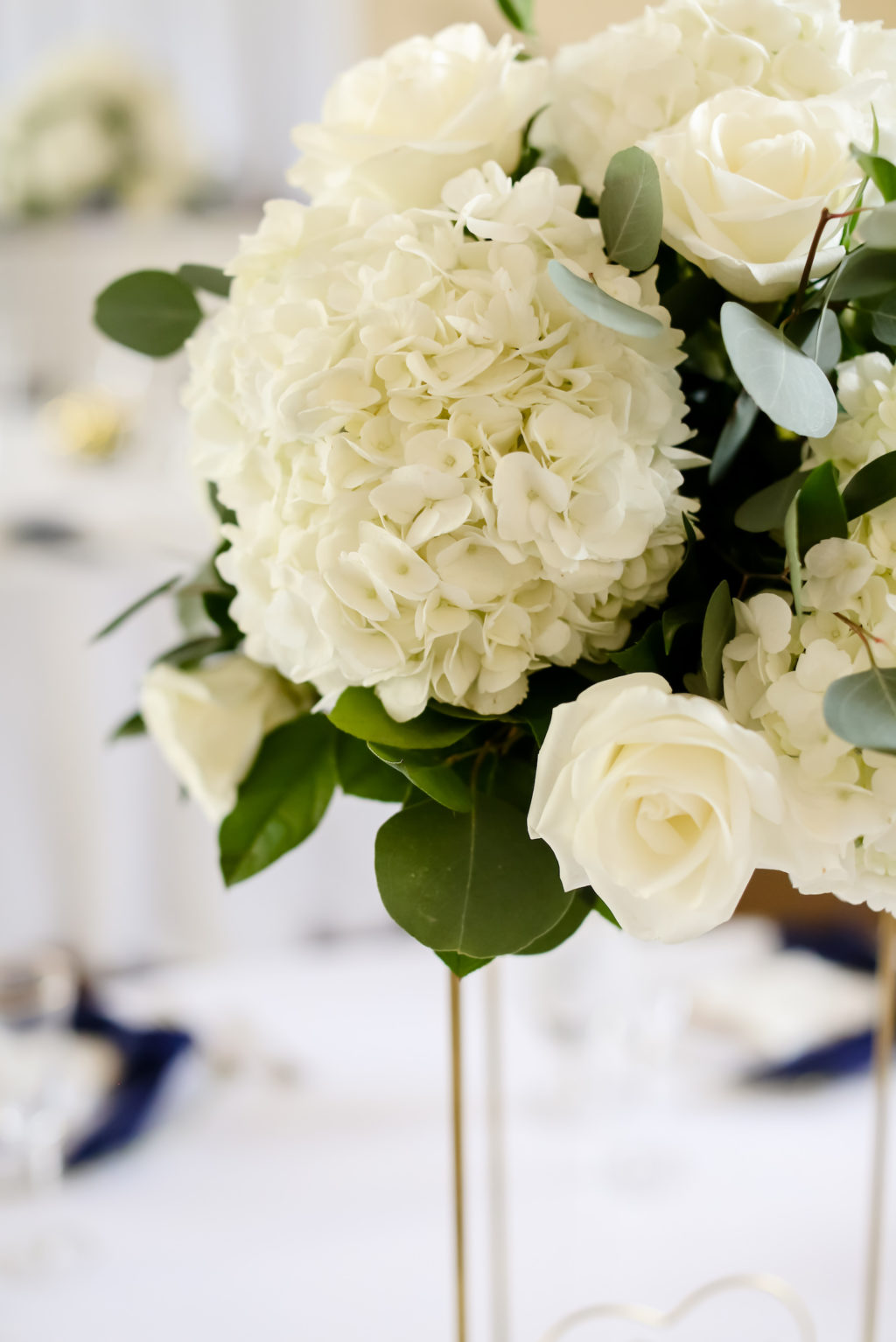 Classic Wedding Reception Decor, White Hydrangeas and Roses with Greenery Floral Centerpiece | Tampa Bay Wedding Photographer Lifelong Photography Studio | Wedding Planner Core Concepts
