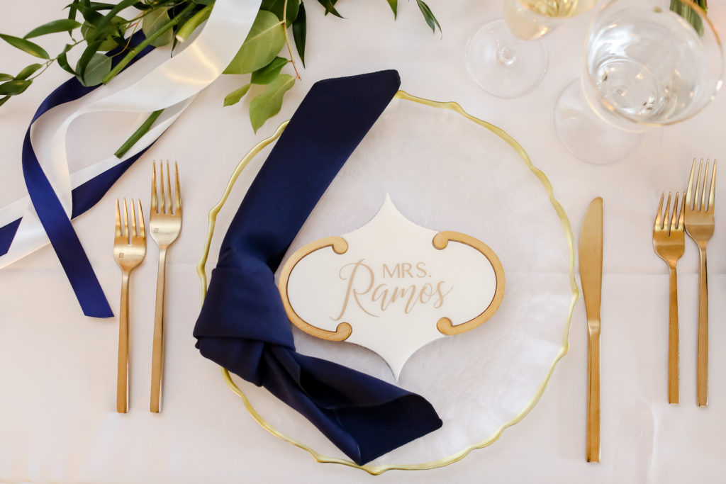 Classic Wedding Reception Decor, Gold Flatware, Gold Rimmed and Milky White Scalloped Charger, Navy Blue Linen Napkin, Geometric White and Gold Personalized Cookie Wedding Favor | Tampa Bay Wedding Photographer Lifelong Photography Studio | Wedding Planner Core Concepts | Wedding Rentals A Chair Affair | Kate Ryan Event Rentals
