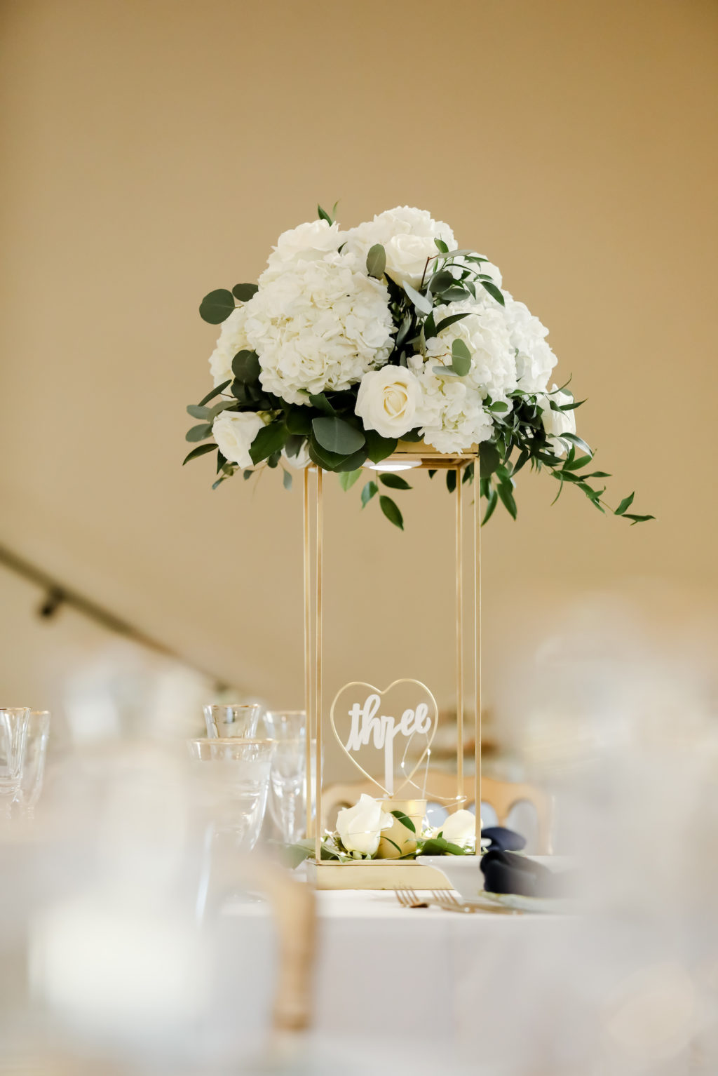 Classic Wedding Reception Decor, Tall Gold Stand with White Hydrangeas, Roses and Greenery Floral Centerpiece | Tampa Bay Wedding Photographer Lifelong Photography Studio | Wedding Planner Core Concepts | Wedding Rentals A Chair Affair | Kate Ryan Event Rentals