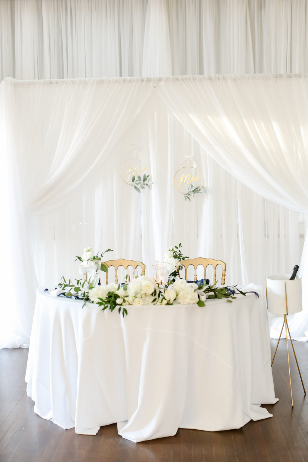 Classic Wedding Reception Decor, Sweetheart Table with White Linen Backdrop, Hydrangeas, Roses and Greenery Floral Bouquets, Gold Chairs | Tampa Bay Wedding Photographer Lifelong Photography Studio | Wedding Planner Core Concepts | Wedding Rentals A Chair Affair | Kate Ryan Event Rentals