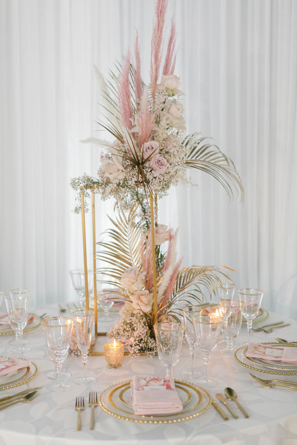 Clearwater Beach Wedding Venue Bellwether Beach Resort Styled With Love Something Bleu by McKenna Bleu | Instagram Wedding Designer Inspiration | Reception Table Linen with Gold Beaded Edge Charger and Gold Flatware with Blush Pink Napkin and Floral Menu Card | Gold Boho Centerpiece with Pampas Grass Roses and Palm Leaves