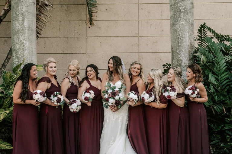 Florida Bride and Bridal Party, Bridesmaids in Long Burgundy Dresses Holding Soft Floral Bouquets with White, Pink, and Greenery Flowers