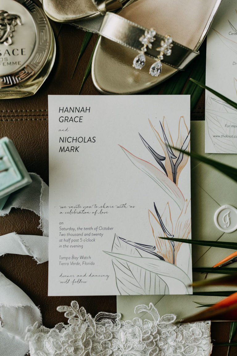 Tropical Elegant Wedding Invitation, Sage Green, White Invitation with Tropical Floral Design, Silver Strappy Wedding Shoes, Versace Perfume Bottle, Wedding Rings in Mint Green Box | Tampa Bay Wedding Photographer Amber McWhorter Photography
