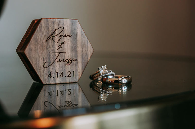 Wedding Ring Shot   Carved Wood Ring Box with Couples Names and Wedding Date   Square Ascher Cut Diamond Solitaire Engagement Ring with Channel Set Diamond Band and Platinum Men Wedding Ring Band