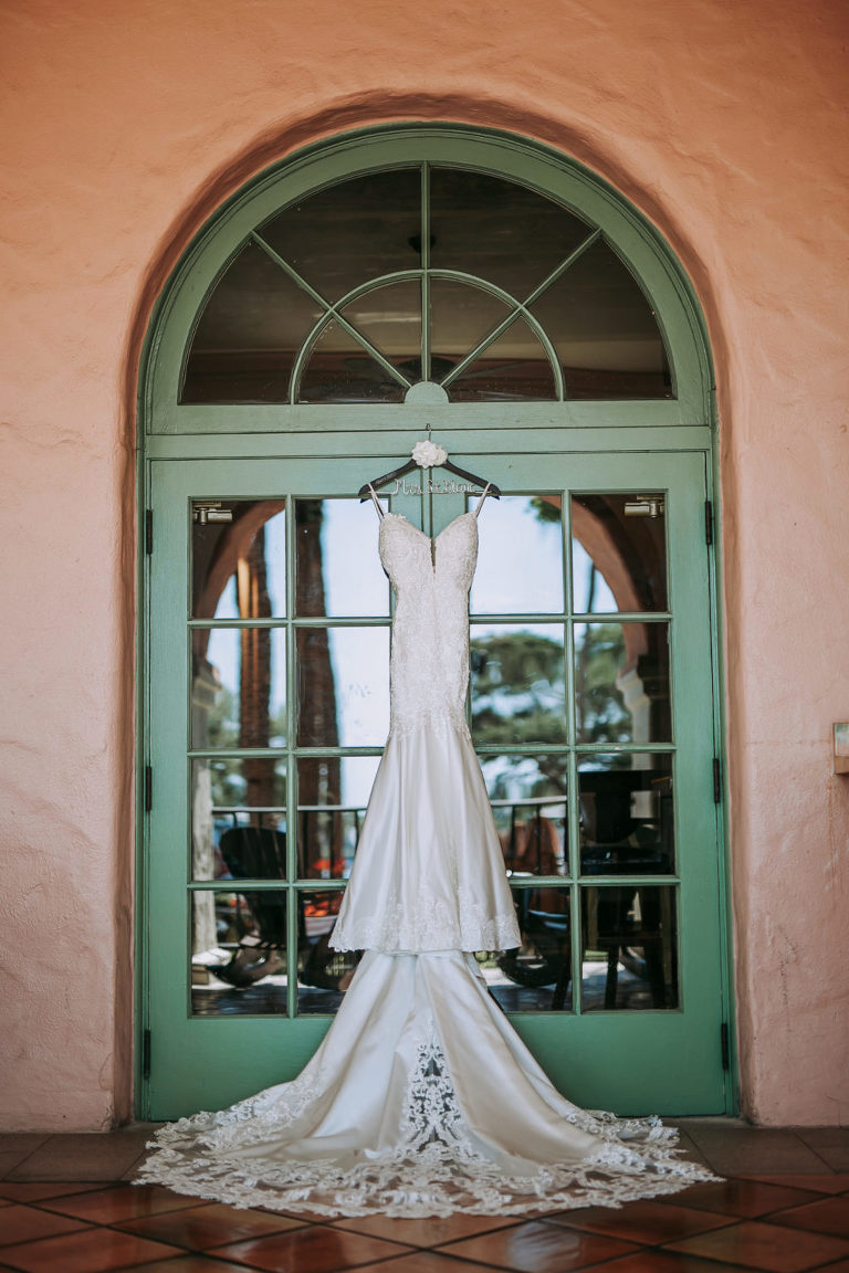 Wedding Dress Hanger Shot on Colorful Green Glass Doorway Arch   Lace Fit and Flare Mermaid Spaghetti Strap Wedding Dress Bridal Gown with Scallop Edge Lace Train Hem