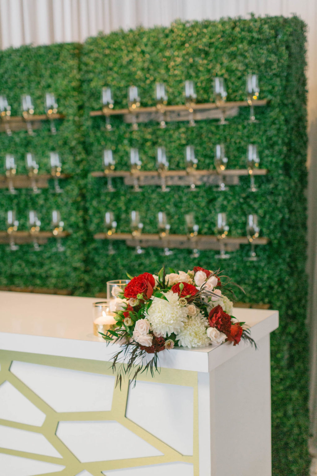 Champagne Glass Hedge Grass Wall with Gold Bar | Styled with Love Influencer Wedding | St. Pete Beach Wedding Venue Bellwether Beach Resort