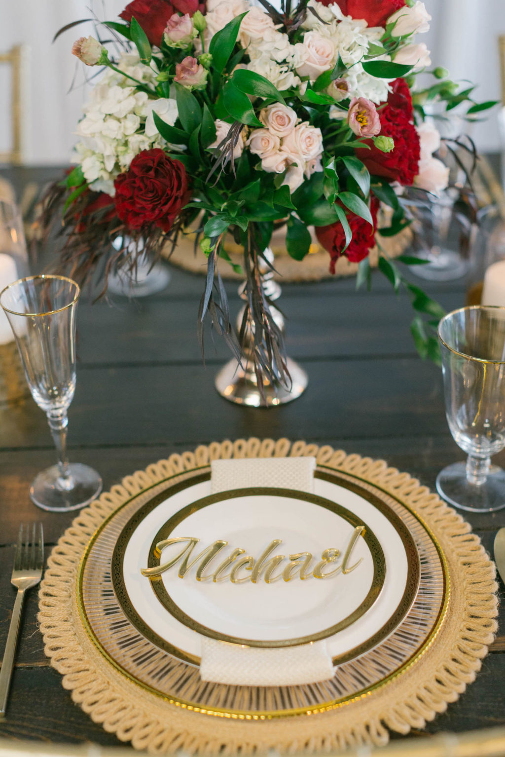 Romantic Red Low Centerpieces with Gold Chargers and Personalized Acrylic Die Cut Name Cards Styled with Love Influencer Wedding | St. Pete Beach Wedding Venue Bellwether Beach Resort