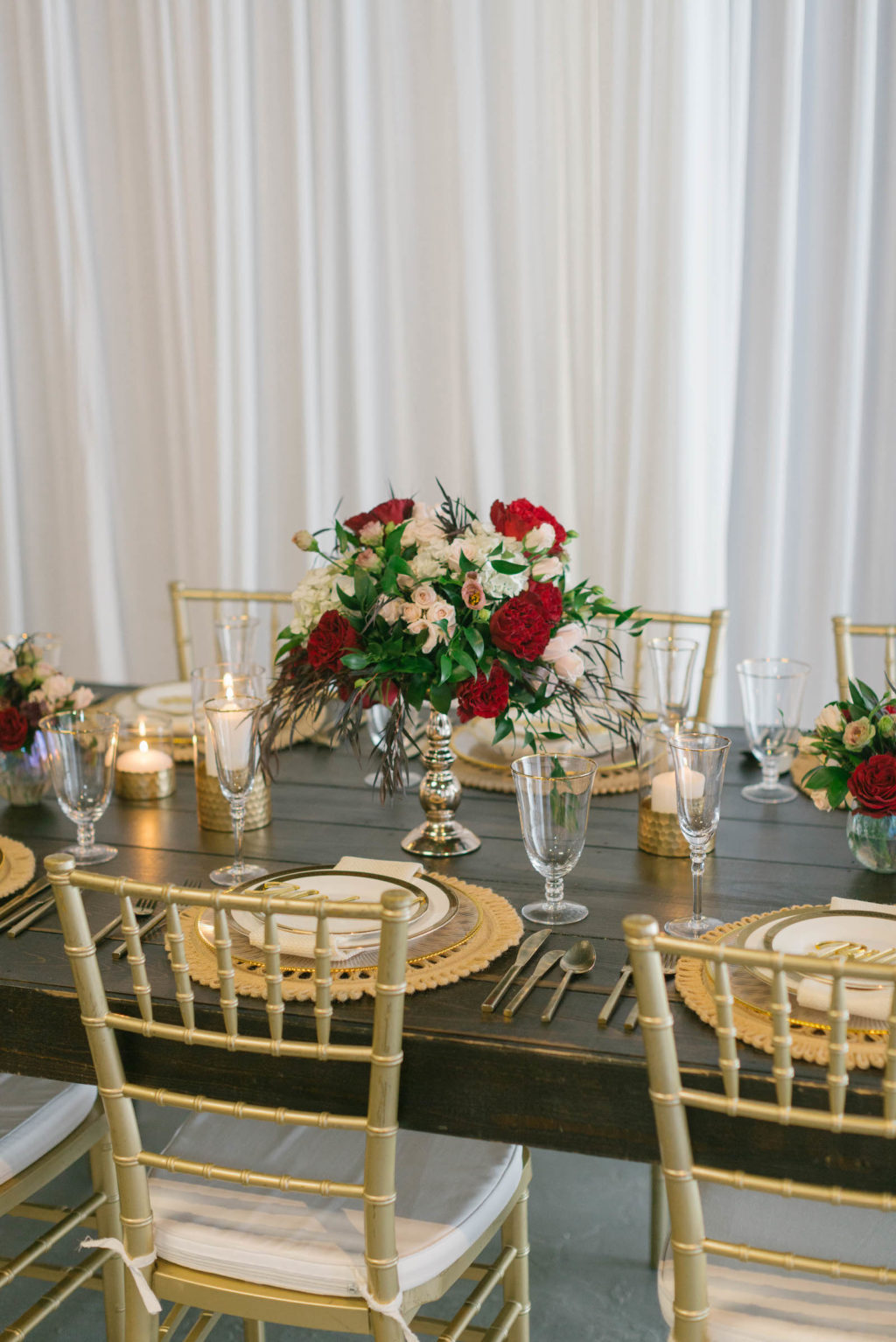 Romantic Red Low Centerpieces with Gold Chargers and Personalized Name Cards Styled with Love Influencer Wedding | St. Pete Beach Wedding Venue Bellwether Beach Resort