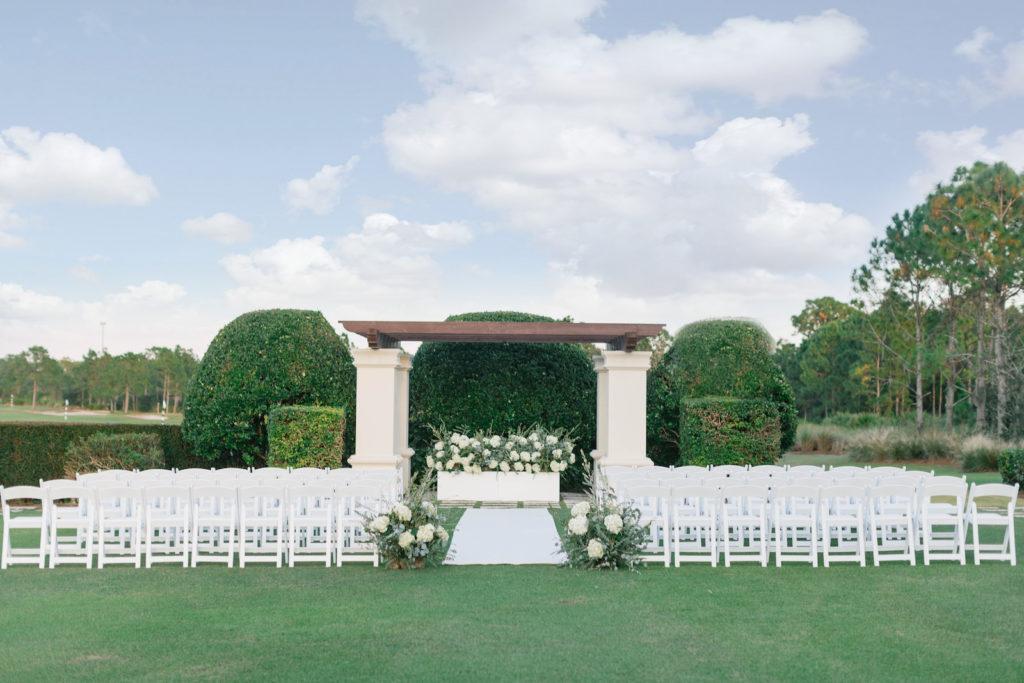 Classic Outdoor Wedding Ceremony Pergola and Lush Floral Arrangements | Tampa Bay Wedding Planner Parties A'la Carte | Wedding Rentals Kate Ryan Event Rentals | Bradenton Wedding Venue Concession Golf Club