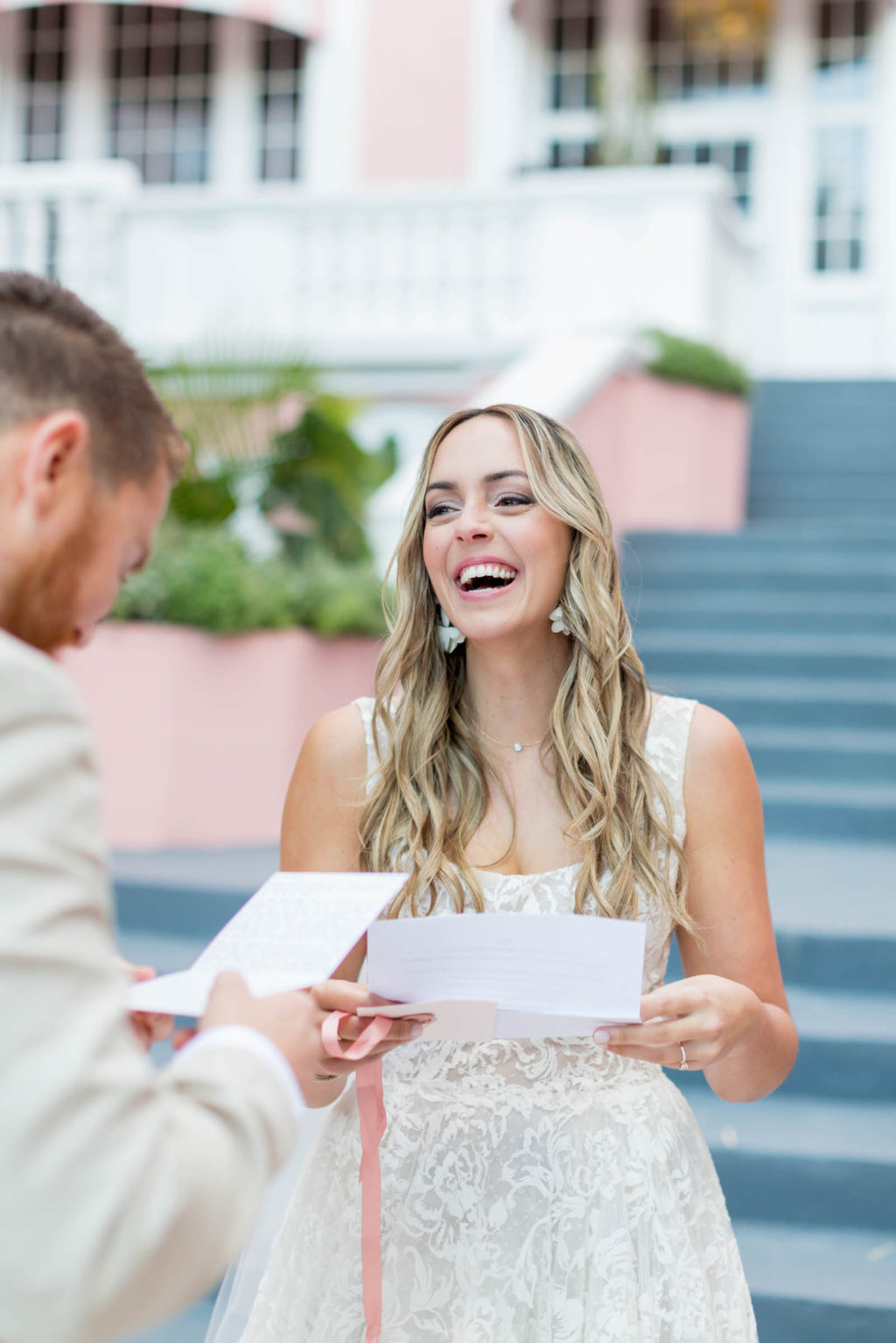 Bride and Groom Outdoor Portrait First Look Reading Love Letters to Each Other