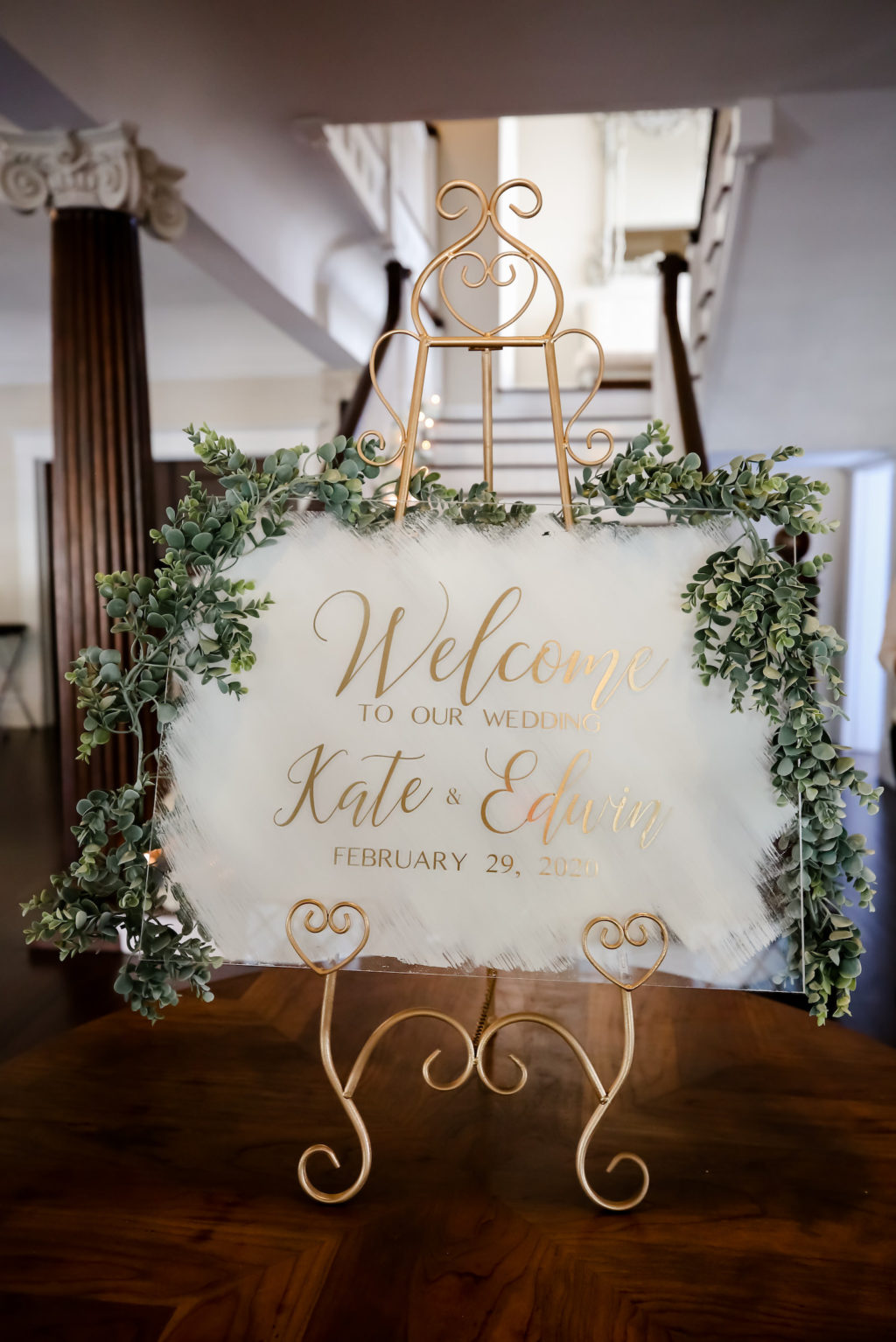 Classic Modern Acrylic and Gold Wedding Welcome Sign with Greenery Garland | Tampa Bay Wedding Photographer Lifelong Photography Studio | Wedding Planner Core Concepts | Wedding Rentals Kate Ryan Event Rentals | A Chair Affair