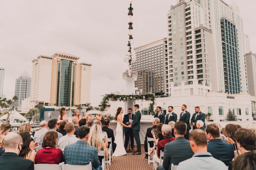 Florida Minimalistic Bride and Groom Exchanging Wedding Vows on Tampa Bay Waterfront Wedding Venue Yacht StarShip | Wedding Photographer and Videographer Bonnie Newman Creative