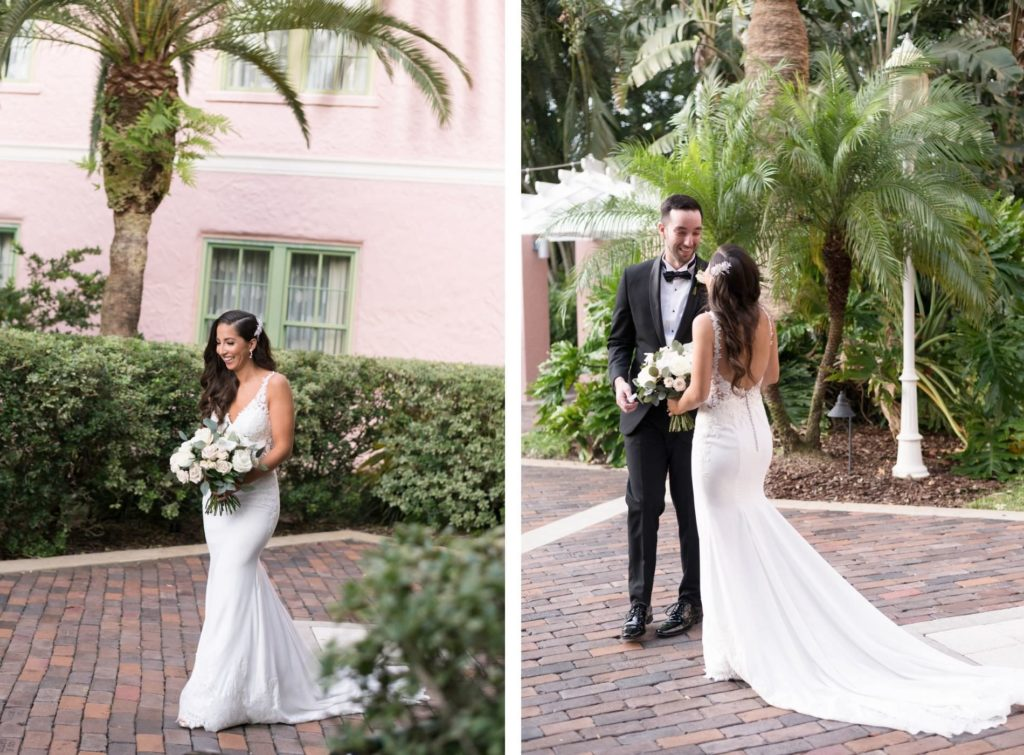 First Look Photo with Groom in Classic Black Tux, Bride Wearing Floral Lace Straps, Illusion and Crepe Fitted Wedding Dress in Courtyard of Hotel St. Pete Wedding Venue The Vinoy Renaissance | Tampa Bay Wedding Photographer Carrie Wildes Photography