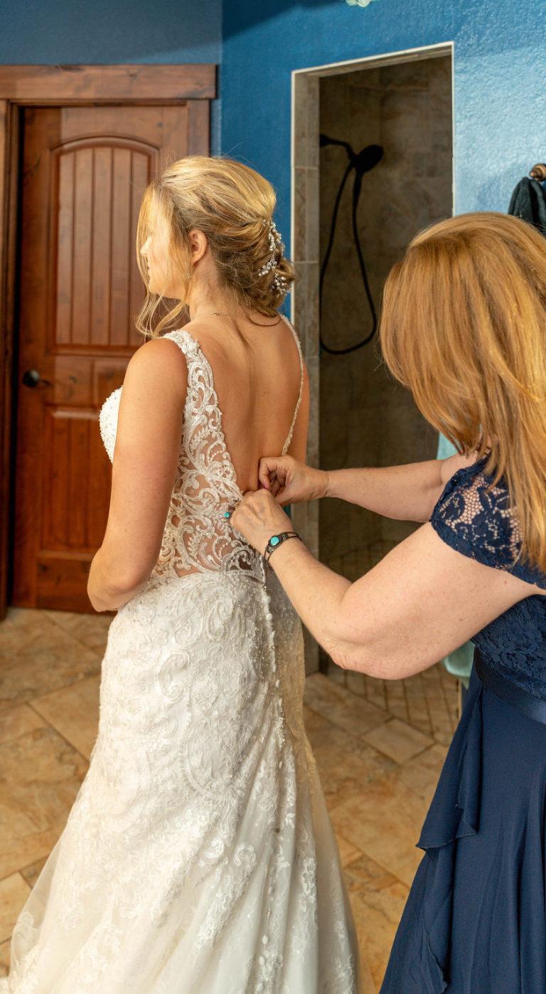 DIY Bride Putting on Lace Open Back Wedding Dress