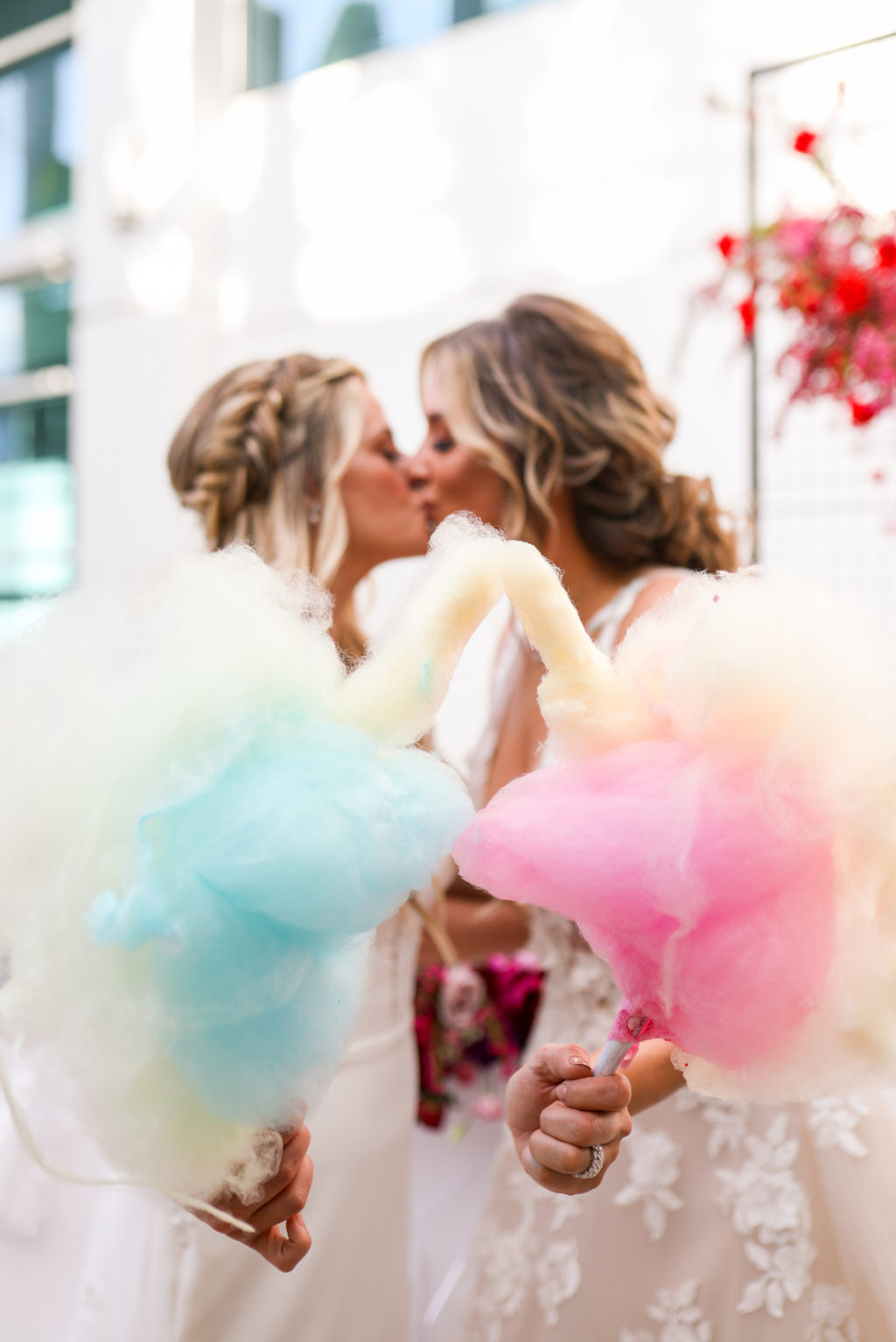 Modern Gay LGBTQ+ Pride Wedding, Lesbian Brides Kissing Holding Pink and Blue Cotton Candy   Tampa Bay Wedding Planner Stephany Perry Events