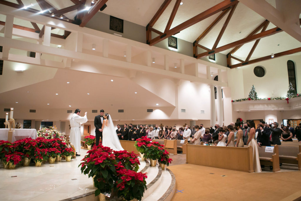 Traditional Bride and Groom Exchanging Wedding Vows Christmas Ceremony at Altar of Wedding Venue St. Raphael Catholic Church | Tampa Bay Wedding Photographer Carrie Wildes Photography