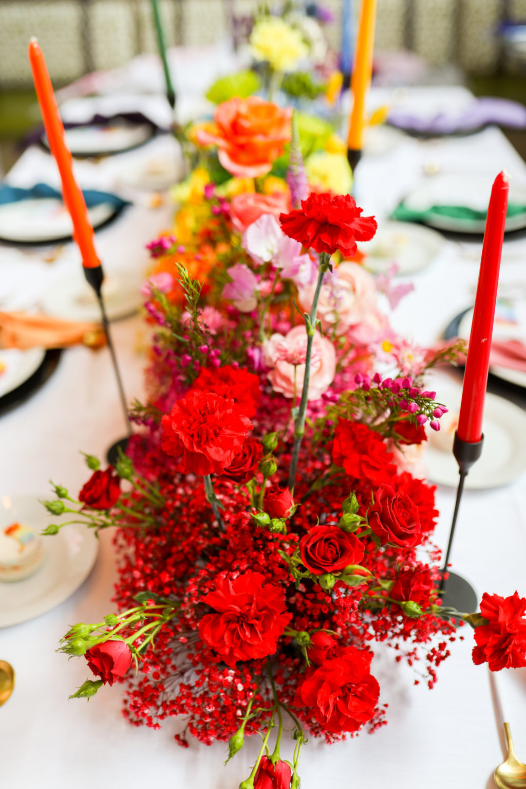 Colorful Rainbow Gay LGBTQ+ Pride Wedding Reception Decor, Red, Pink, Yellow Flower Long Centerpiece and Candlesticks   Tampa Bay Wedding Planner Stephany Perry Events