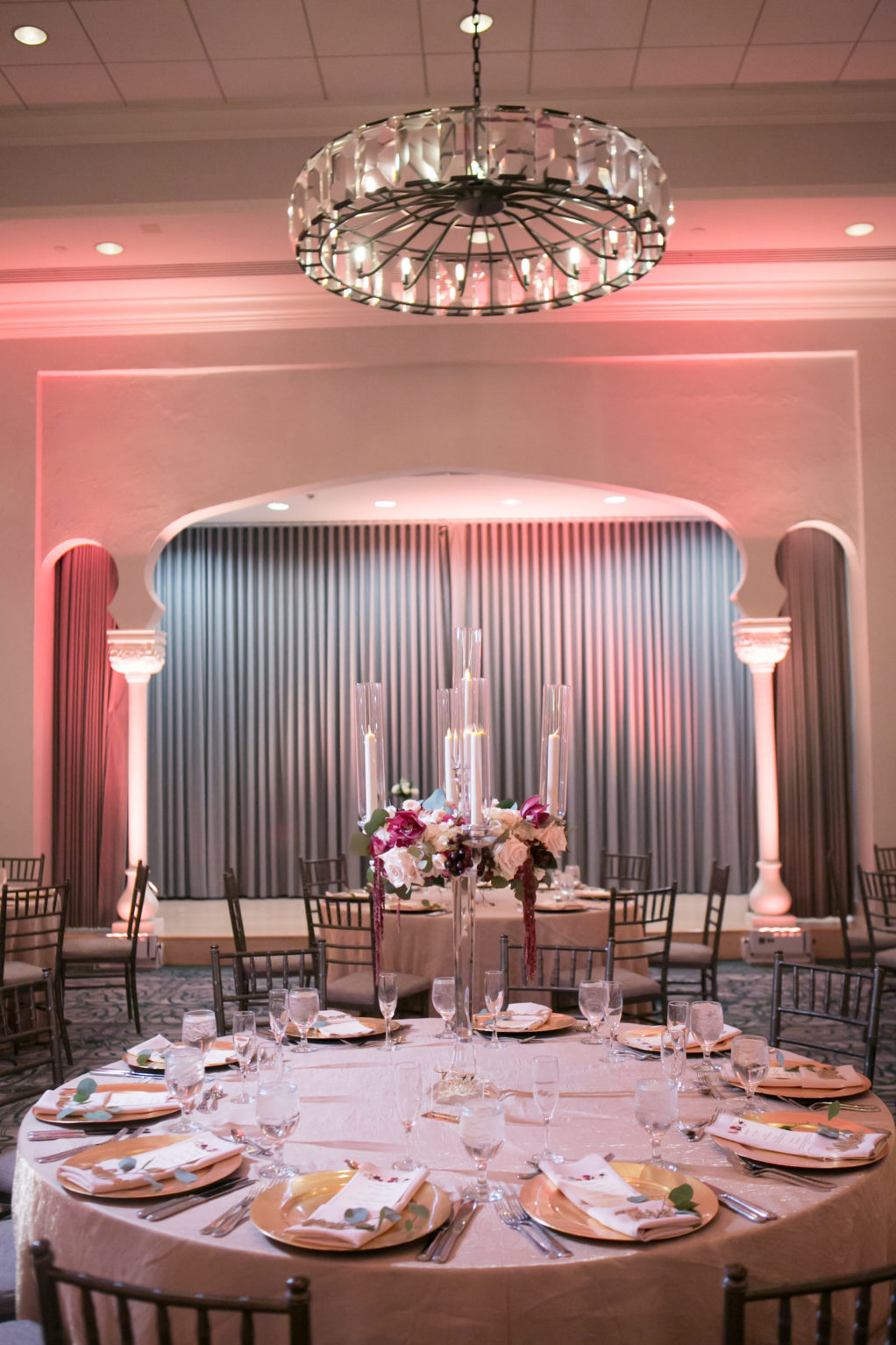Elegant Ballroom Wedding Reception Decor, Gold Chargers, Pink Uplighting, Tall Glass Candle Centerpieces | Tampa Bay Wedding Photographer Carrie Wildes Photography | St. Pete Wedding Venue Vinoy Renaissance