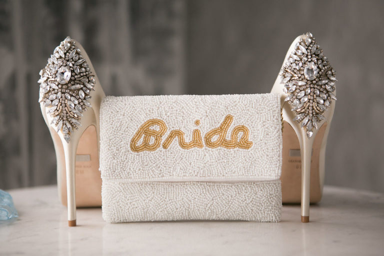Elegant Bride Wedding Accessories, White Beaded Clutch with Gold Word Bride Beaded, Ivory Badgley Mischka Wedding Shoes with Rhinestone Brooch | Tampa Bay Wedding Photographer Carrie Wildes Photogrpahy