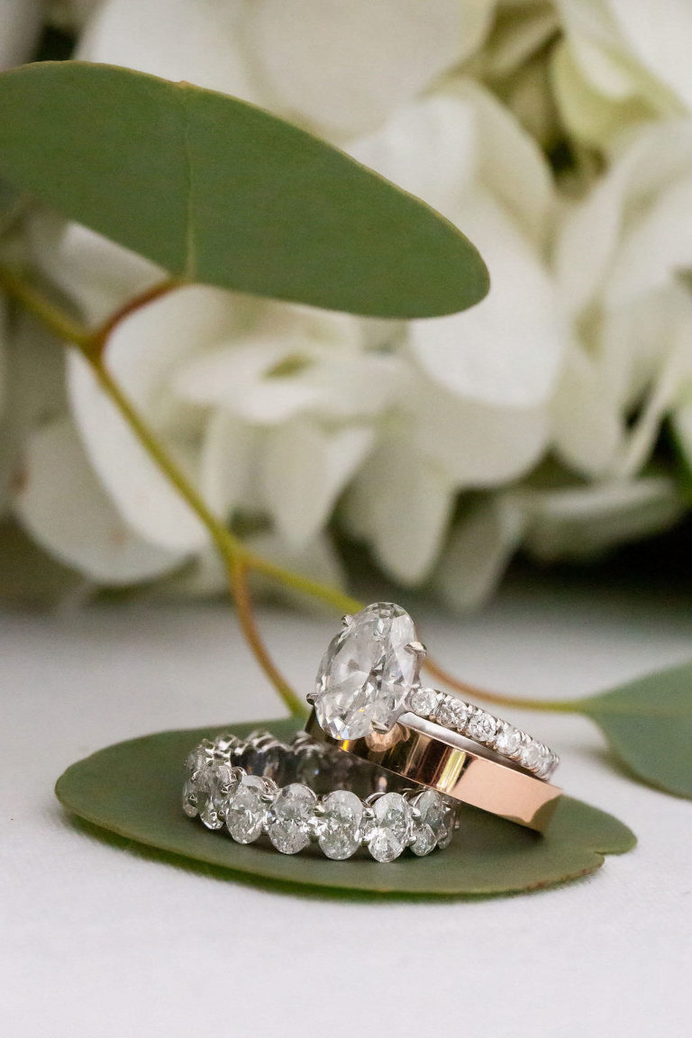 Wedding Ring Shot | Oval Solitaire Diamond Engagement Ring with Channel Set Diamond Band and Rose Gold Polished Band
