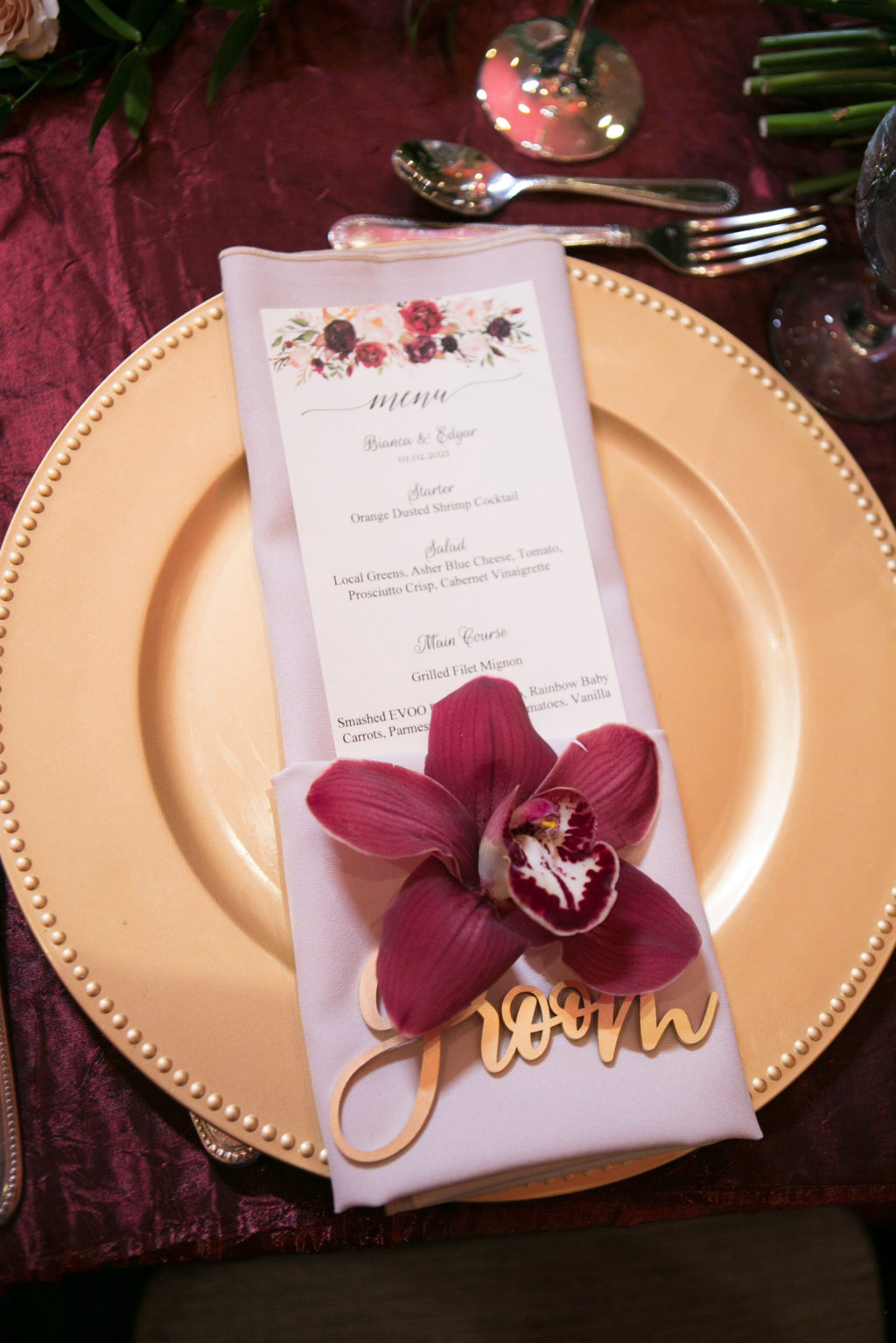 Elegant Wedding Reception Decor, Gold Charger, Burgundy Orchid, Laser Cut Groom Place Card, Floral Stationery Menu | Tampa Bay Wedding Photographer Carrie Wildes Photography