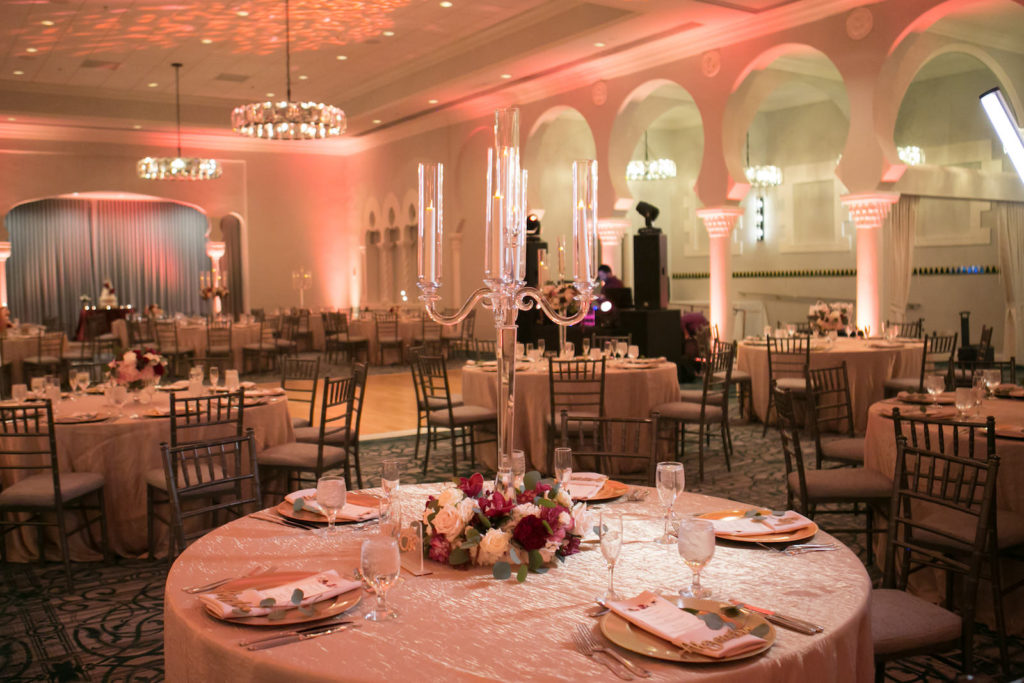 Elegant Ballroom Wedding Reception Decor, Gold Chargers, Pink Uplighting, Tall Glass Candle Centerpieces with Burgundy and White Floral Arrangement | Tampa Bay Wedding Photographer Carrie Wildes Photography | St. Pete Wedding Venue Vinoy Renaissance