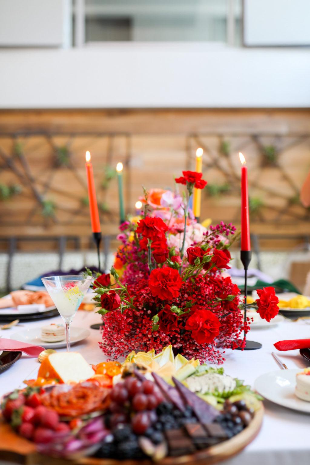 Colorful Rainbow Gay LGBTQ+ Pride Wedding Reception Decor, Red Flower Centerpiece, Candlesticks   Tampa Bay Wedding Planner Stephany Perry Events   Wedding Venue Hotel Alba