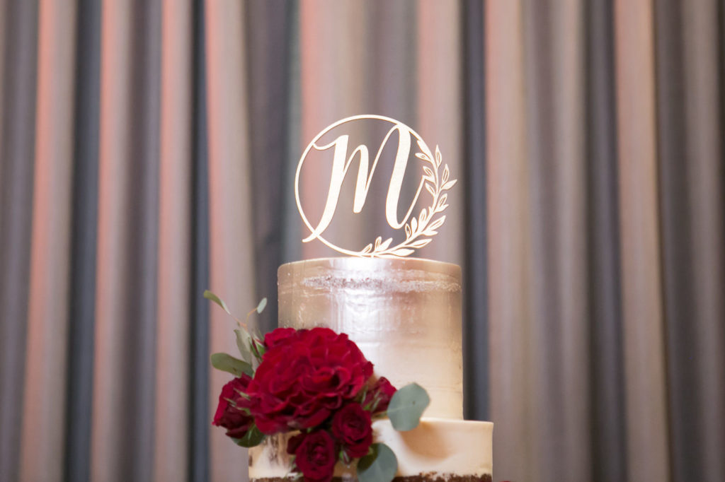 Elegant Four Tier with Piped Buttercream Roses, Textured Buttercream, Semi Naked and Silver Painted Wedding Cake, Laser Cute Monogram Cake Topper, Burgundy Red Roses on Gold Cake Stand and Burgundy Red Table Linen | Tampa Bay Wedding Photographer Carrie Wildes Photography | St. Pete Wedding Baker The Artistic Whisk