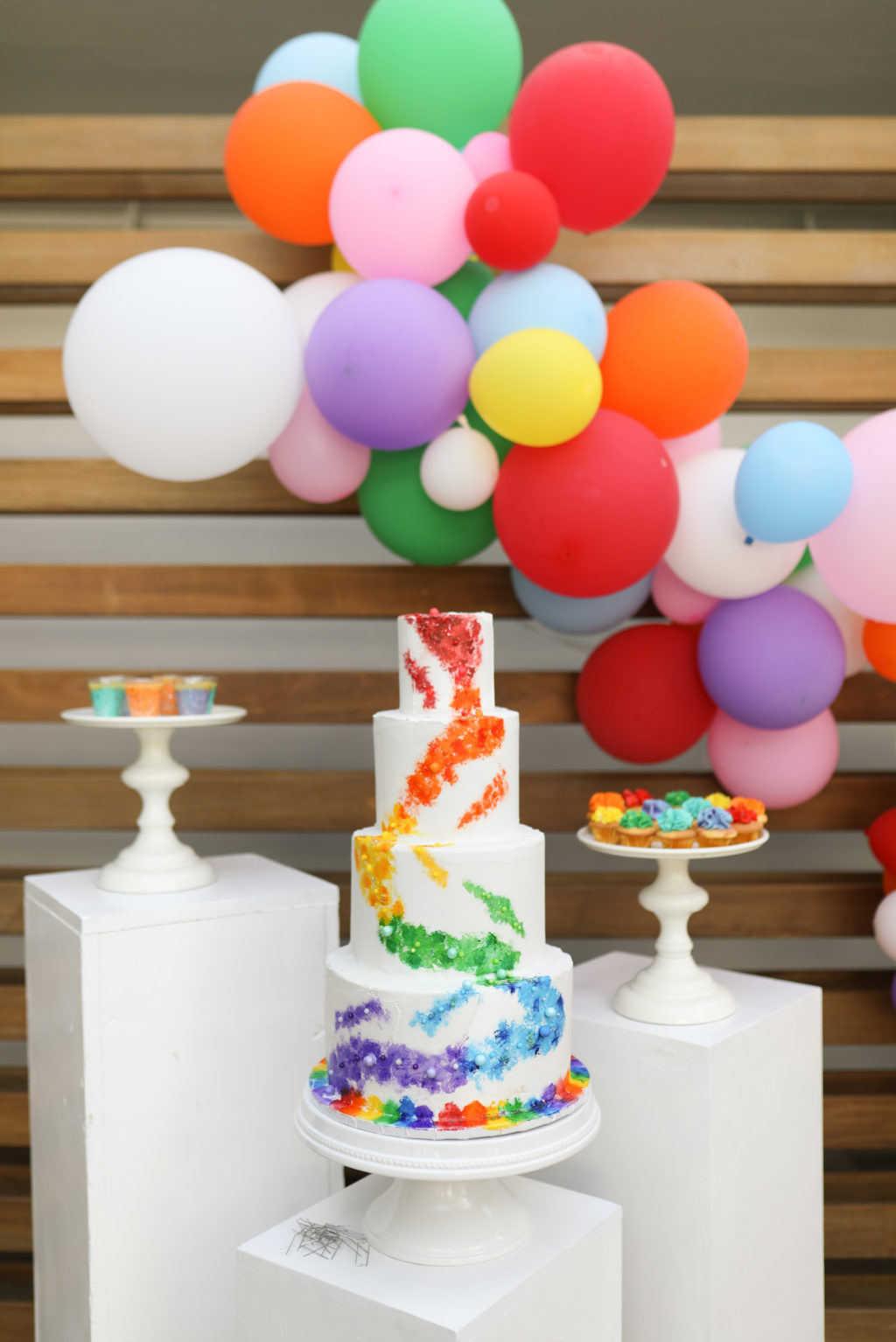 Unique Modern Gay LGBTQ+ Pride Wedding, Four Tier White with Rainbow, Purple, Blue, Green, Yellow, Orange and Red Painted Colors, Colorful Balloon Arch   Tampa Bay Wedding Planner Stephany Perry Events