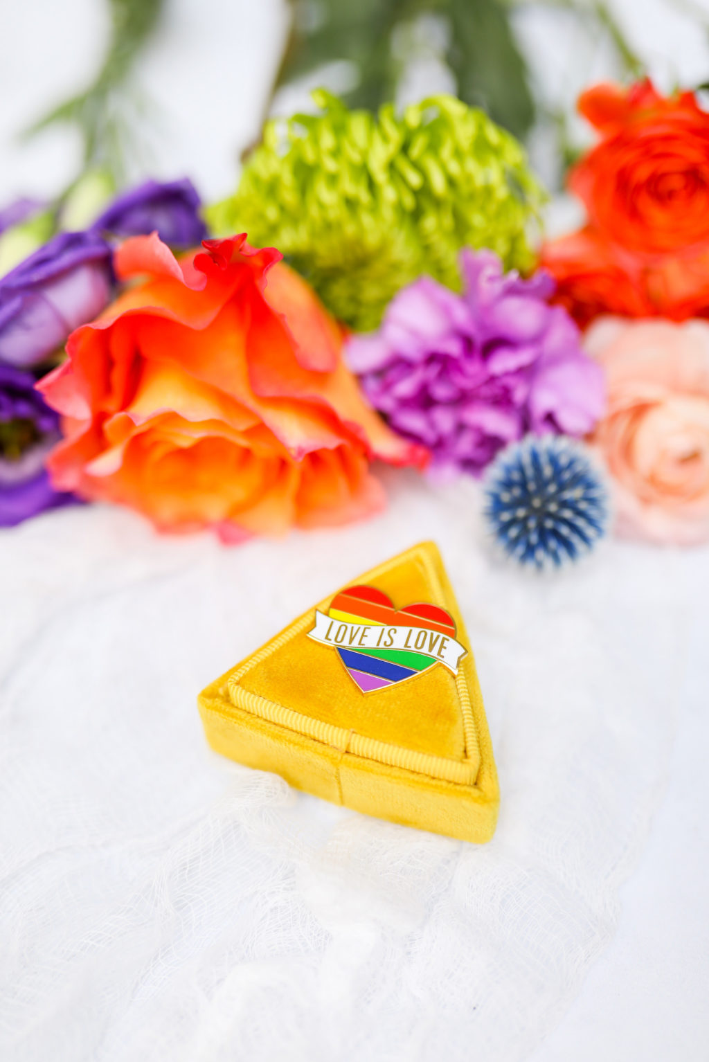 Gay LGBTQ+ Pride Wedding, Yellow Ring Box with Love is Love Rainbow Pin, Red, Purple, Green Flowers