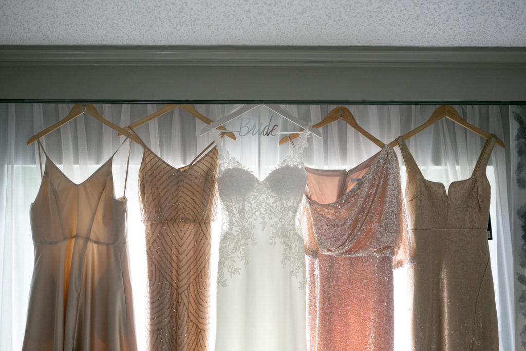 Elegant Lace, Crepe and Illusion V Neckline Wedding Dress, Mix and Match Blush Pink and Champagne, Neutral Beaded Bridesmaids Dresses | Tampa Bay Wedding Photographer Carrie Wildes Photography | Wedding Dress Shop Isabel O'Neil Bridal Collection