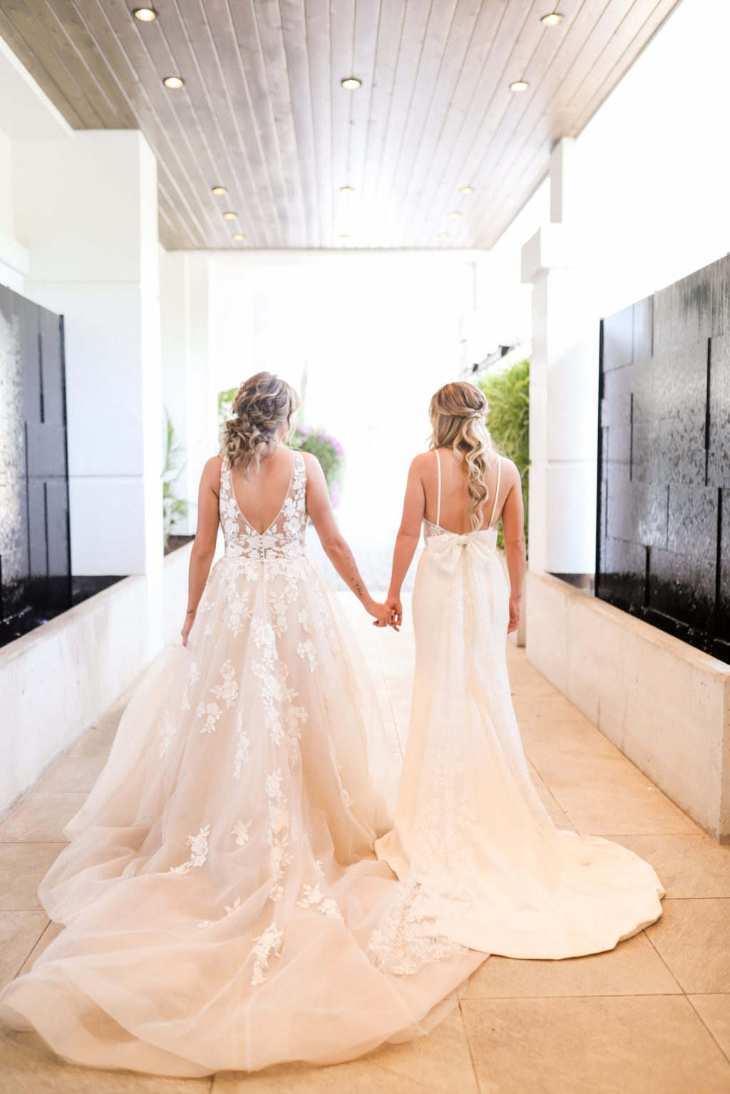 Gay LGBTQ+ Pride Wedding, Lesbian Brides in Romantic Wedding Dresses, Lace and Illusion Open V Back A-Line Wedding Dress, Fitted Open Back Spaghetti Strap Wedding Dress with Bow   Tampa Bay Wedding Venue Hotel Alba