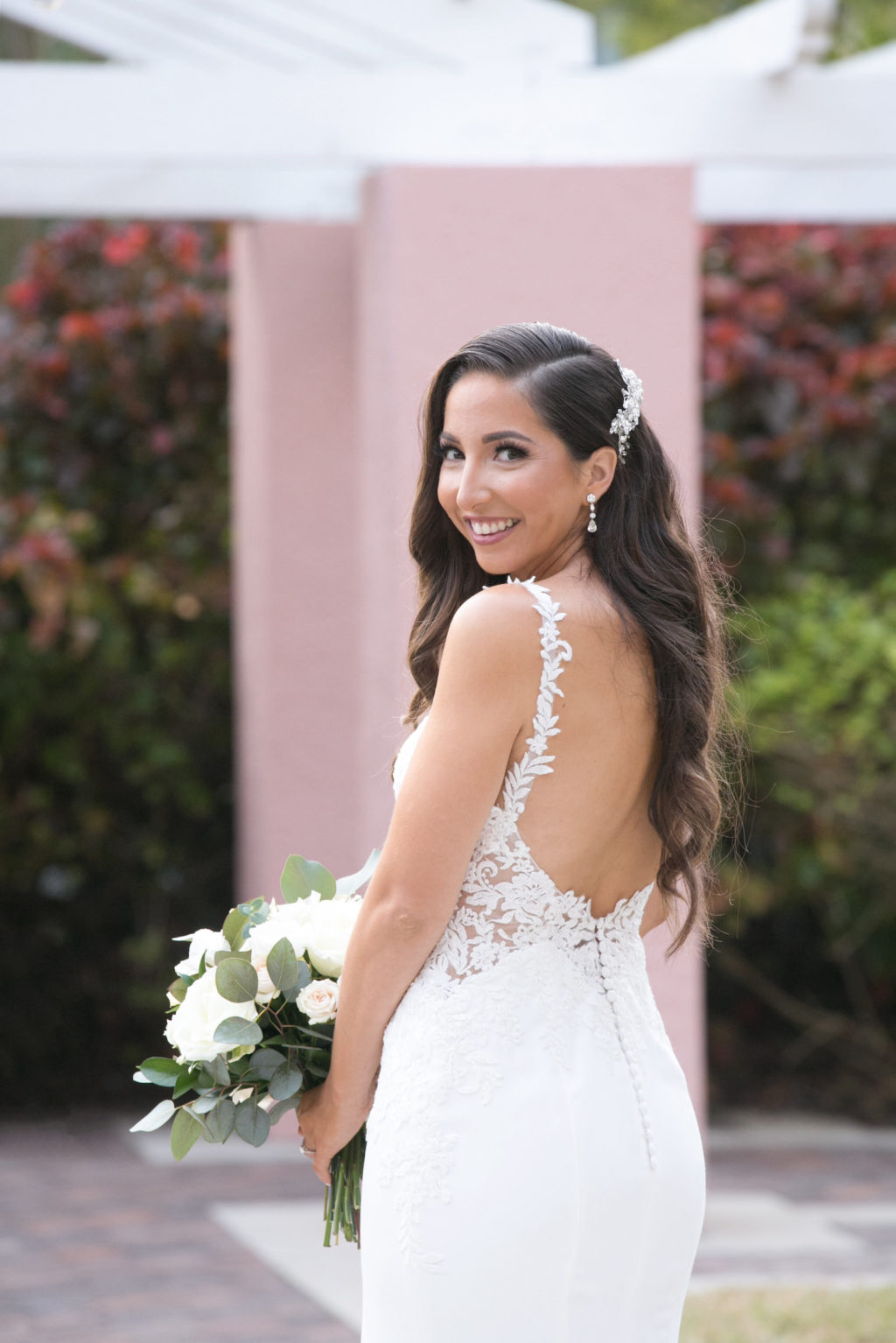 Elegant Bride in Romantic Open Back Floral Lace Straps, Illusion and Crepe Fitted Wedding Dress Holding White and Greenery Floral Bouquet | Tampa Bay Wedding Photographer Carrie Wildes Photography | Wedding Dress Shop Isabel O'Neil Bridal Collection