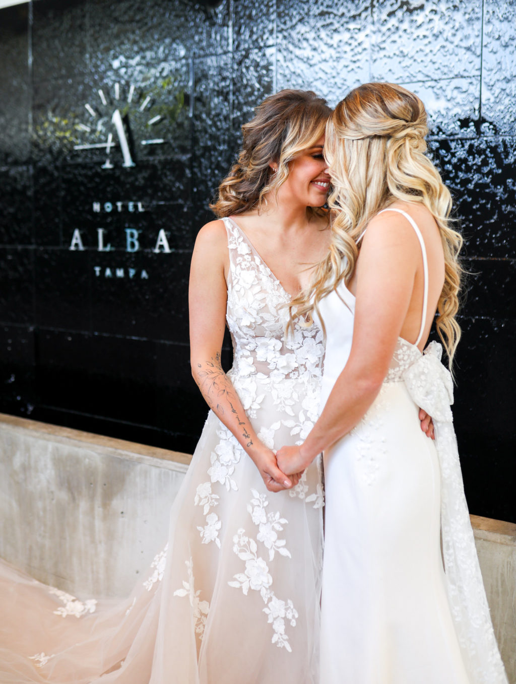 Gay LGBTQ+ Pride Wedding, Lesbian Brides in Floral Applique Lace, Illusion and Tulle Off White Plunging V Neckline Wedding Dress, Fitted Spaghetti Strap Open Back with Bow Wedding Dress   Tampa Bay Wedding Venue Hotel Alba