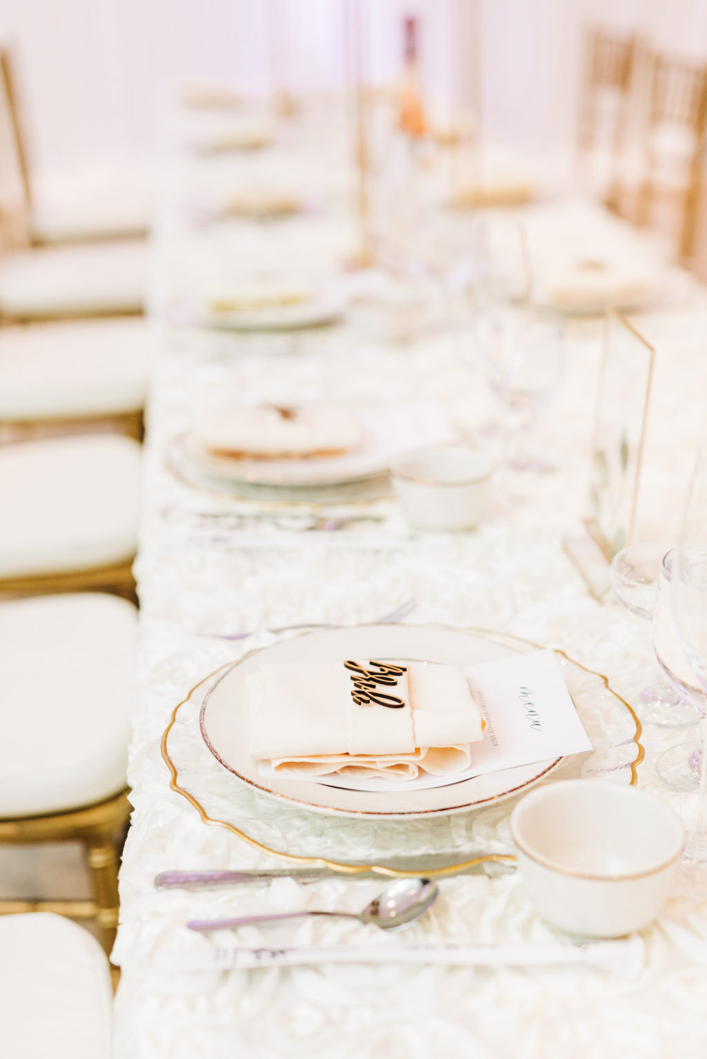 Elegant Garden Wedding Reception Decor, Long Feasting Table with White Floral Table Linen, Scalloped Gold and Clear Charger   Tampa Bay Wedding Rentals Kate Ryan Event Rentals