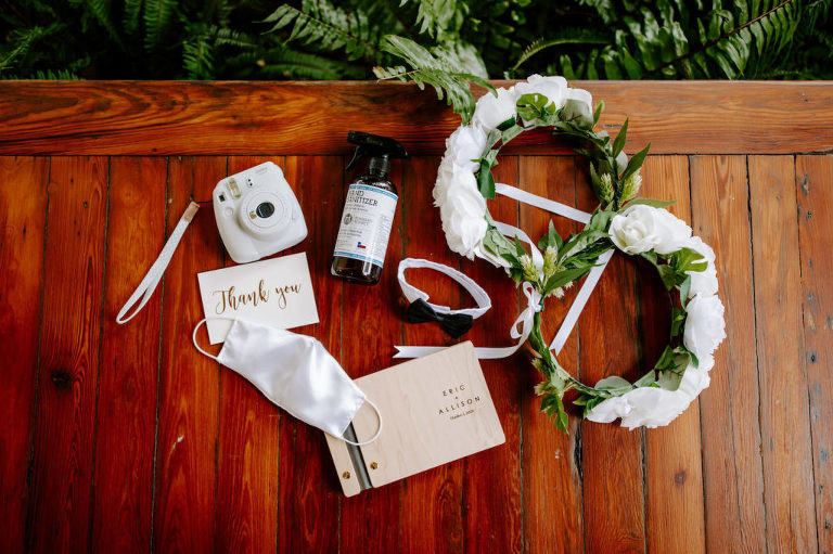 Garden Inspired Florida Wedding Details, White Flower Crowns, Modern Wooden Engraved Guest PhotoBook with White Polaroid Camera Snapshots, White Masks and Handed Sanitizer For Pandemic Safe Wedding, Bowtie Dog Collar   Tampa Bay Luxury Wedding Planner Parties A'La Carte
