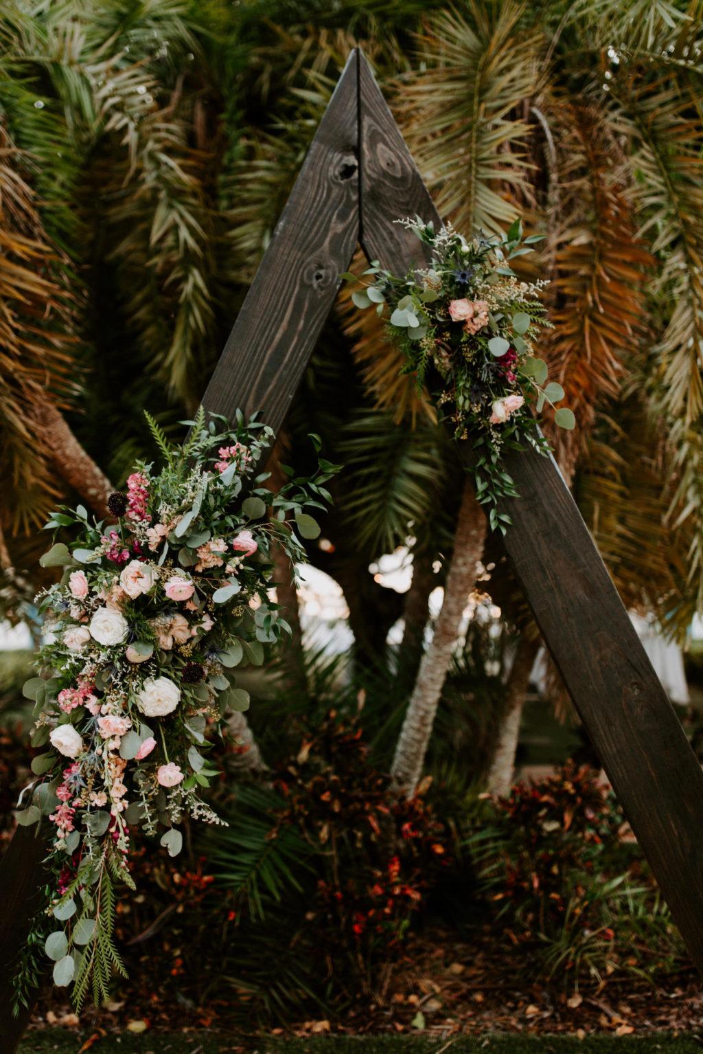 Tropical Boho Garden Wedding Ceremony Decor, Triangular Wooden Arch with Lush Floral Arrangements   St. Pete Wedding Venue Postcard Inn on the Beach