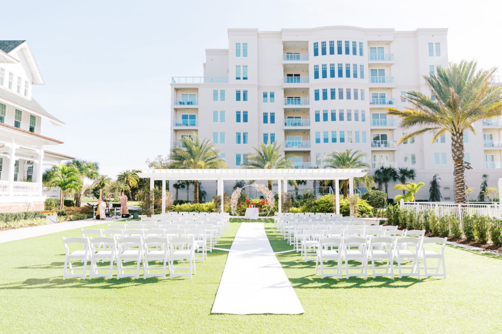 Elegant Outdoor Clearwater Lawn Wedding Ceremony and Decor at Belleview Inn, Large Floral Circle Arch with Blush Pink Cherry Blossoms, White Aisle Runner | Florida Luxury Wedding Planner Parties A'La Carte