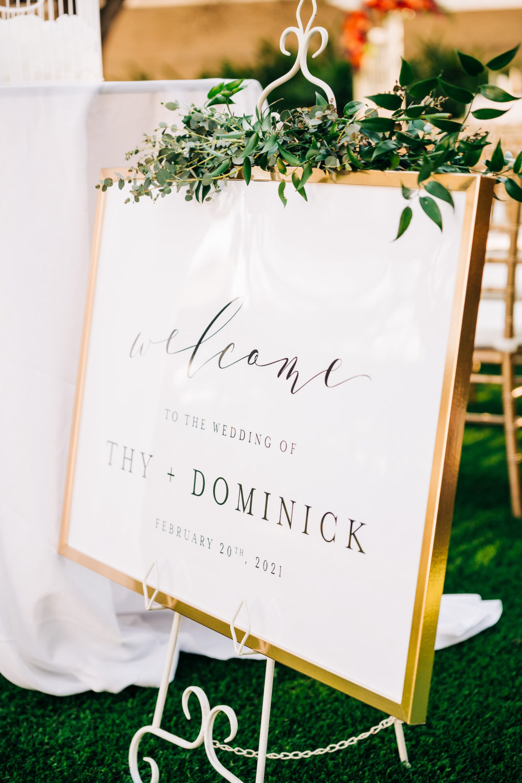 Elegant Garden Wedding Ceremony Decor, White Welcome Sign in Gold Frame with Greenery Garland   Tampa Bay Wedding Florist Monarch Events and Design