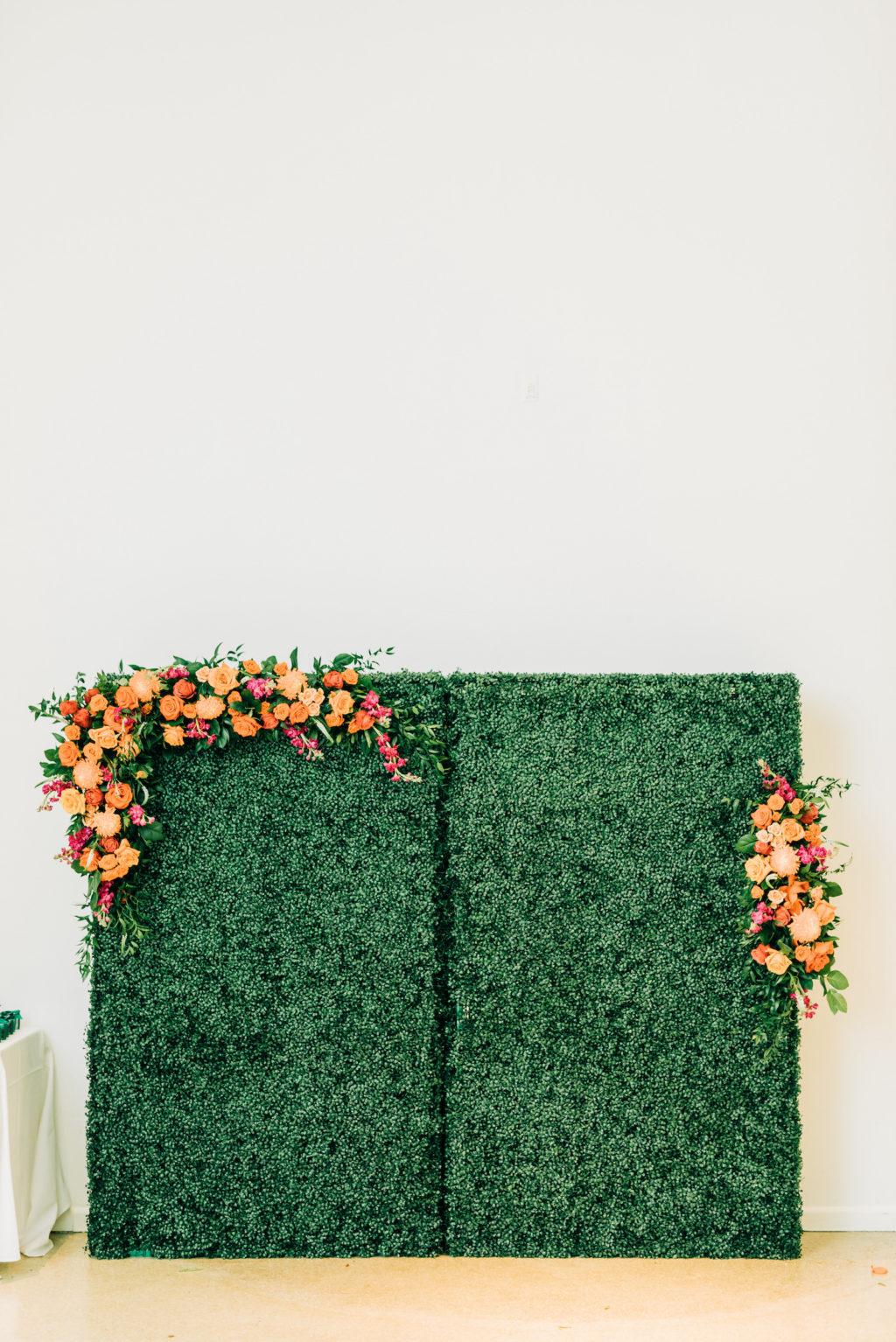 Garden Wedding Reception Decor, Greenery Hedge Backdrop with Vibrant Colorful Pink, Orange Lush Floral Arrangements   Tampa Bay Wedding Florist Monarch Events and Design   Wedding Rentals Kate Ryan Event Rentals