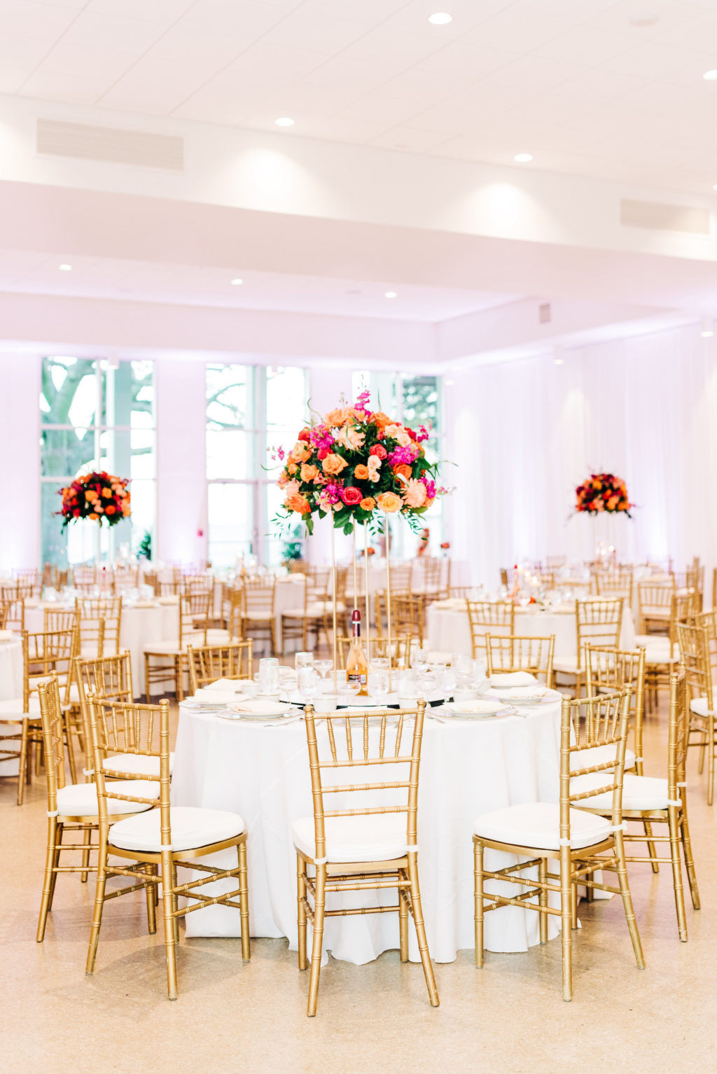 Elegant Wedding Reception Decor, Round Tables with White Table Linens, Gold Chiavari Chairs, Tall Gold Stand with Lush Vibrant Colorful Pink, Orange and Greenery Floral Centerpiece   Wedding Venue Tampa Garden Club   Wedding Rentals Kate Ryan Event Rentals   Wedding Florist Monarch Events and Design
