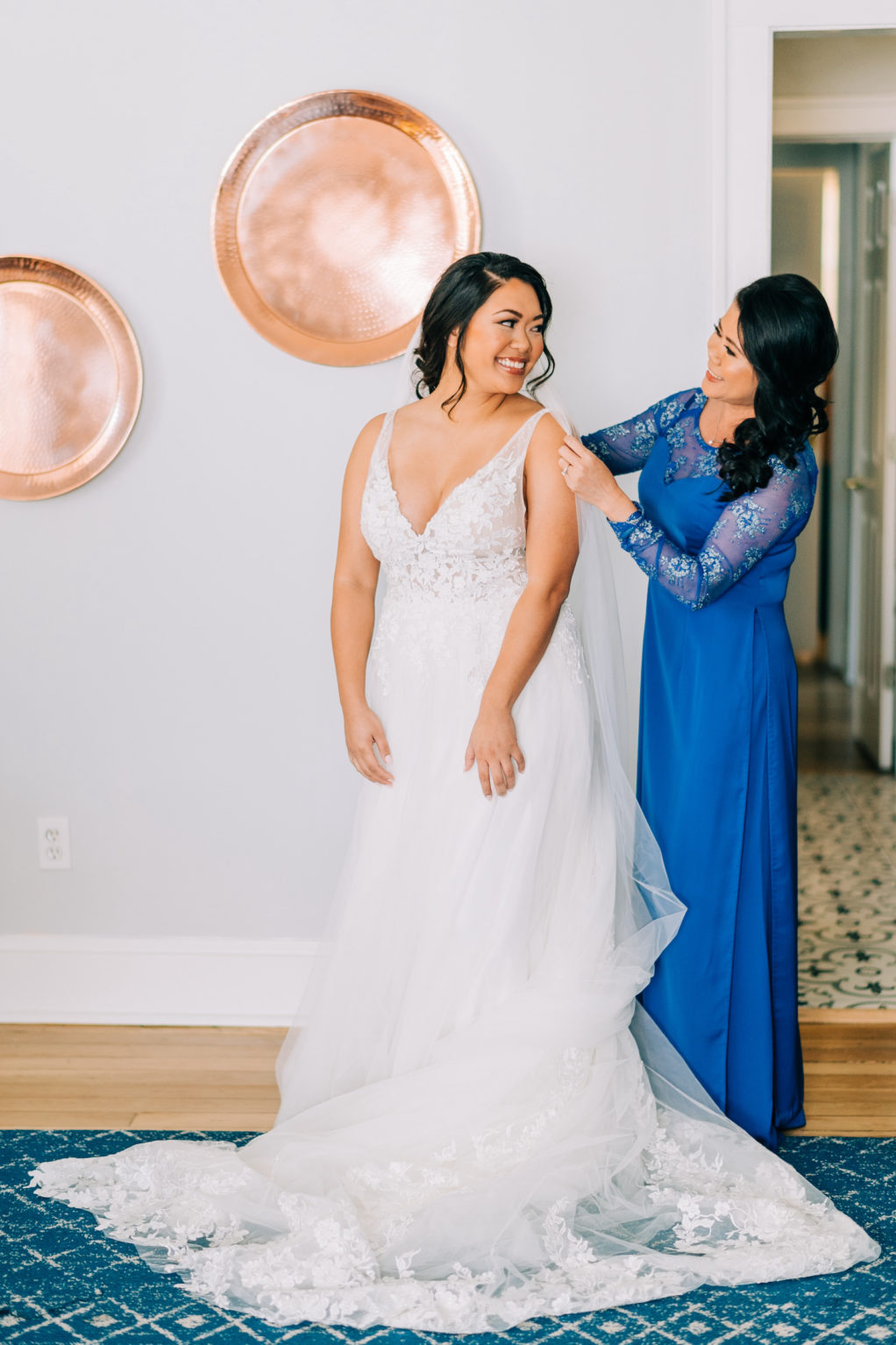 Tampa Bay Bride Getting Wedding Ready with Mom in Lace V Neckline with Straps Bodice and Tulle A-Line Skirt with Full Length Veil